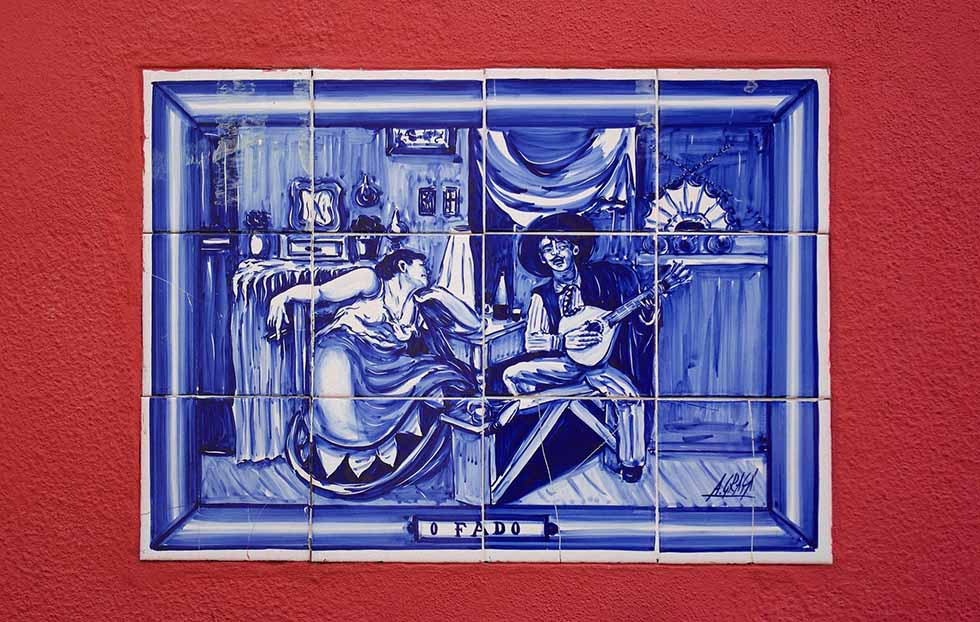 Blue tiles on a red wall in Lisbon #Portugal #travel #Europe