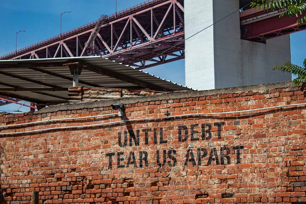 Until debt tear us apart mural at LX Factory in Lisbon #Portugal #Europe #Travel