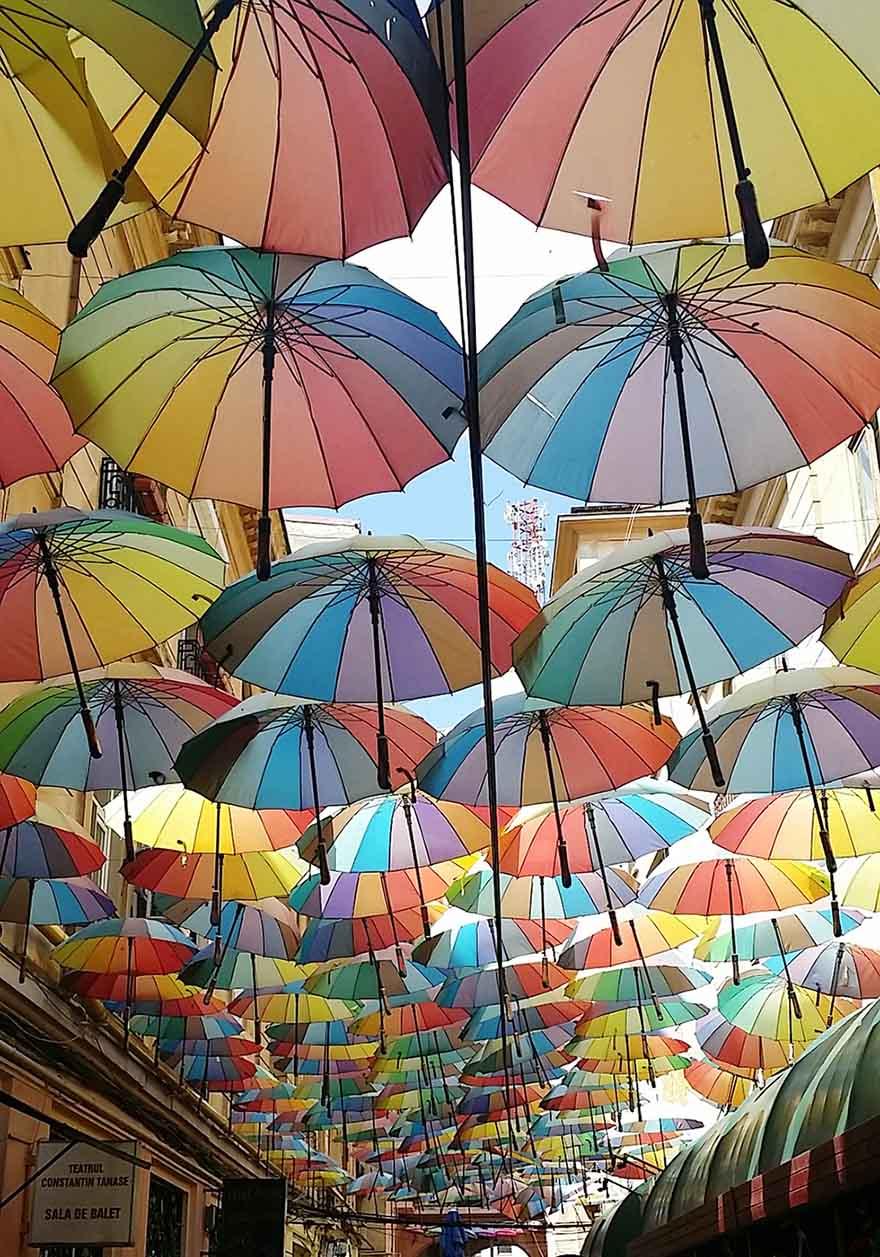 Colorful umbrellas covering the Victoria Passage in Bucharest, Romania.