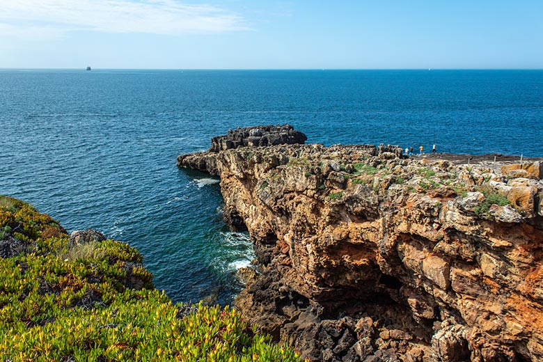 Rock formation and blue ocean in Cascais