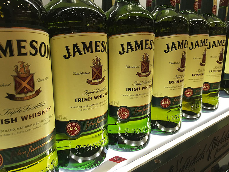 Bottles of Irish whiskey Jameson on a shelf