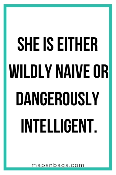 "Sassy quote for Instagram written in black on a white background ""She is either wildly naive or dangerously intelligent""."
