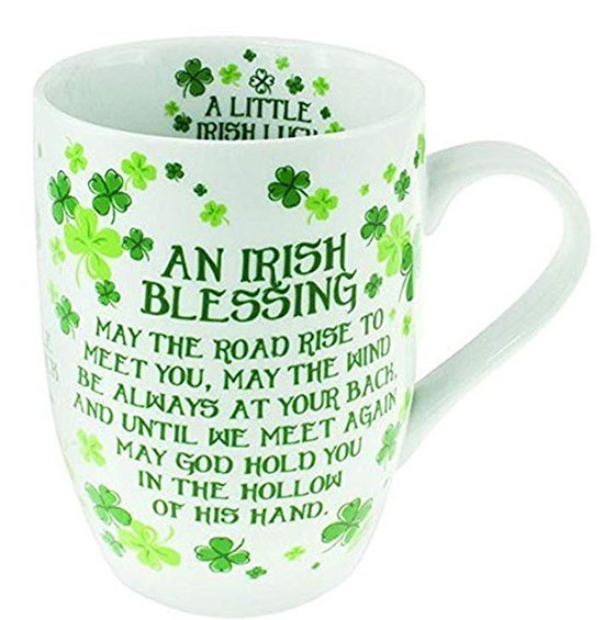 Irish blessing written in green on a white mug