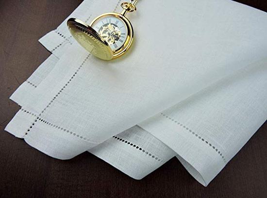 White handkerchief on a dark table