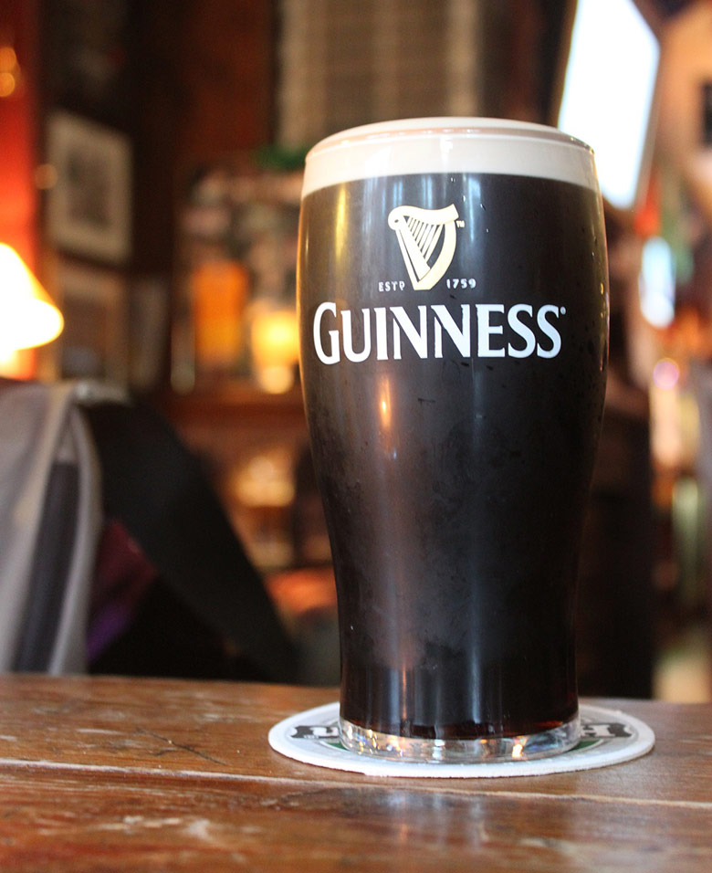 Glass of the dark Irish beer, Guinness