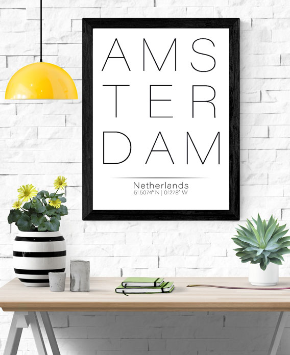 Black frame with white wall art with the word Amsterdam in black