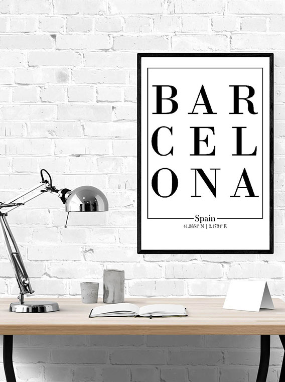 Black frame with white wall art with the word Barcelona in black