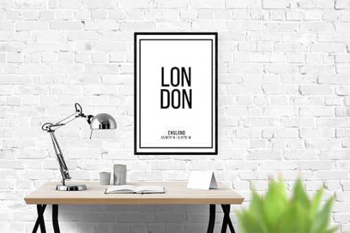 Black frame with white wall art with the word London in black