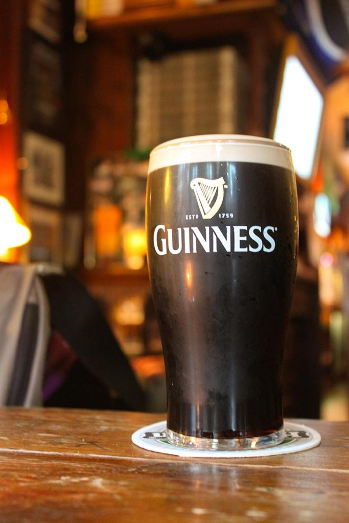 A dark beer in a glass of Guinness in a pub is the most popular Irish drink