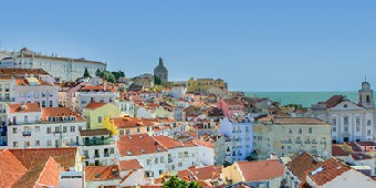 Orange roofs and colorful houses in Lisbon