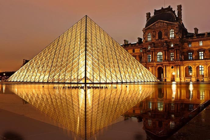 Louvre Museum at night in Paris