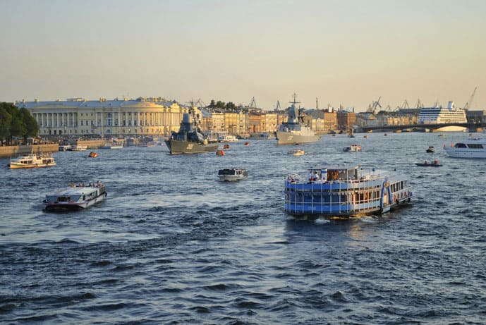 Boats sailing Neva River in St Petersburg, Russia
