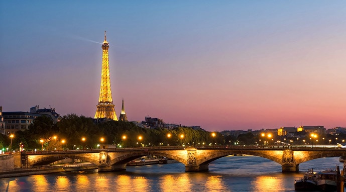 Is Paris the City of Love? The Eiffel Tower lit up in this romantic city.
