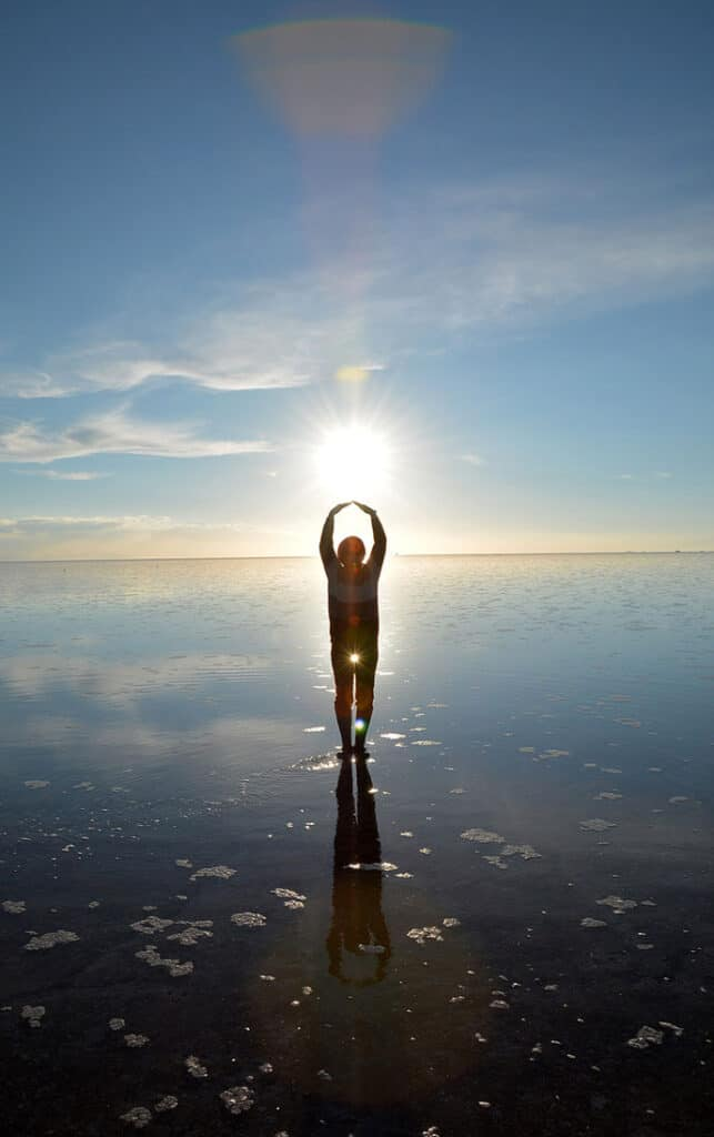 Person in the Bolivian salt flats playing with reflection