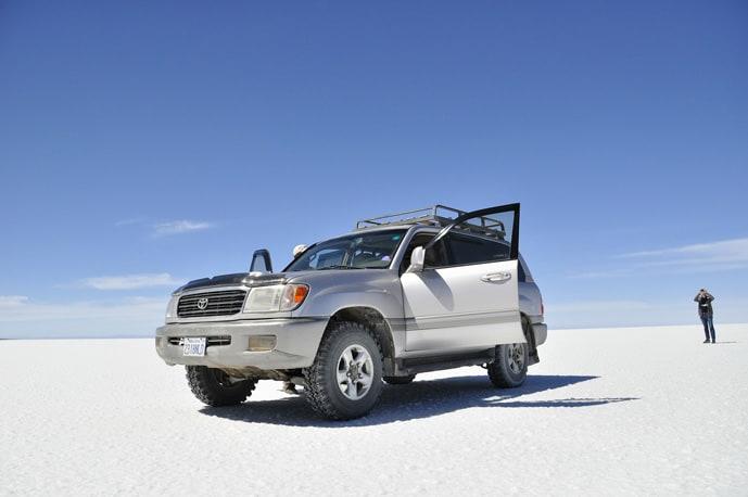 Car at salt flats in Bolivia