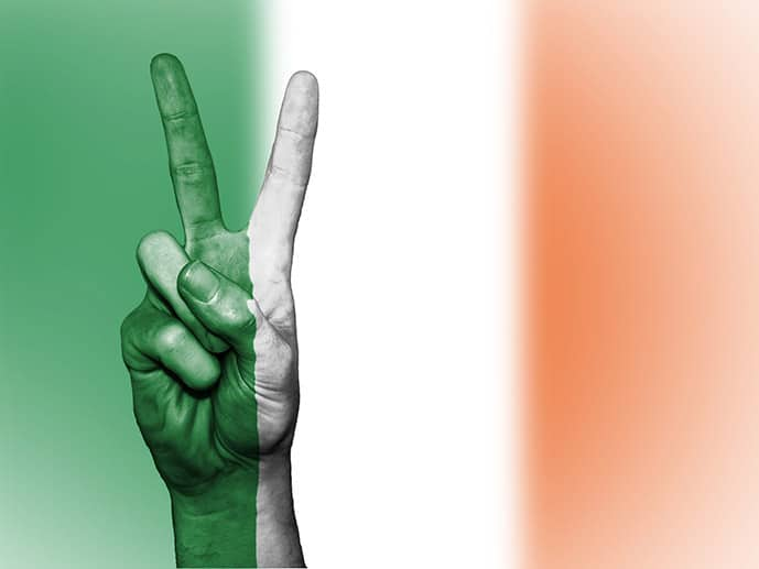 Flag of Ireland and hand with peace sign