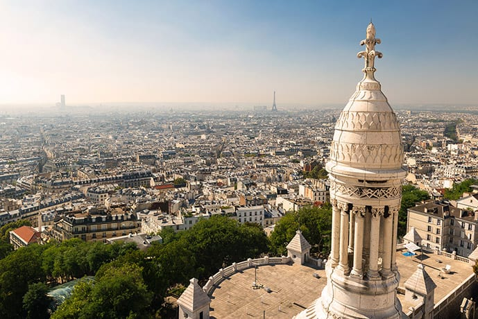 Montmartre is one of the best areas to stay in Paris. In the picture, an incredible view of Paris from the Sacre-Coeur