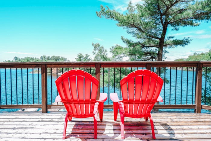 Red chairs in Muskoka, a great Canada road trip