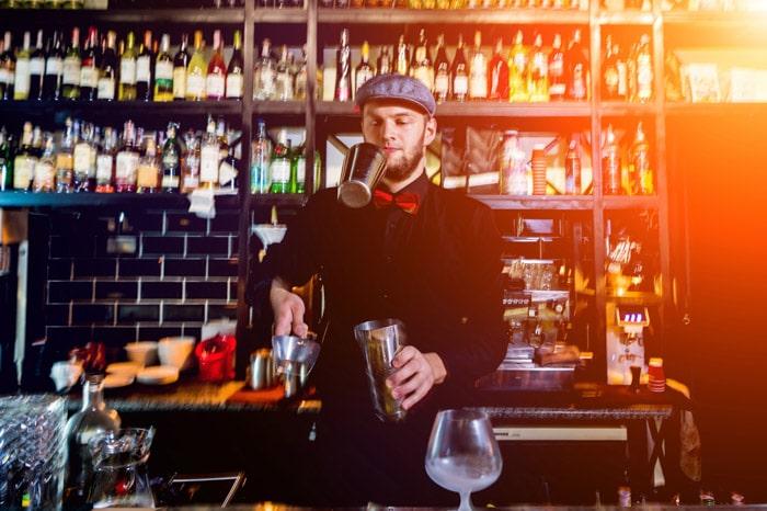 Bartender in vintage bar in London