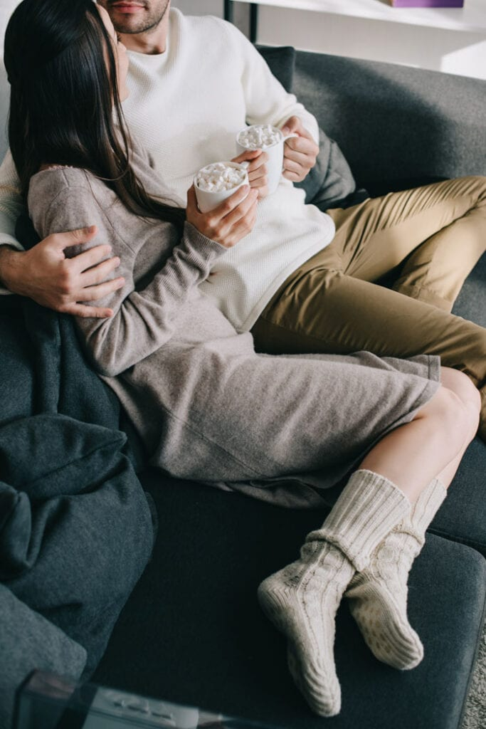 Couple cozy in the couch