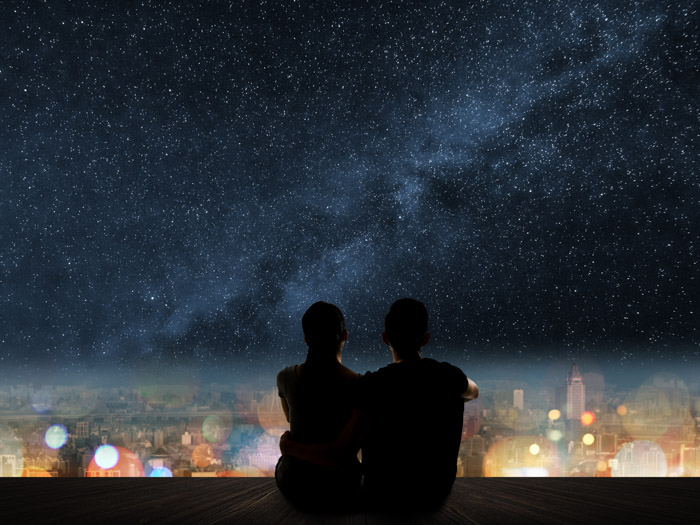Couple sitting under the stars