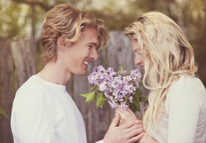 Romantic couple holding flowers
