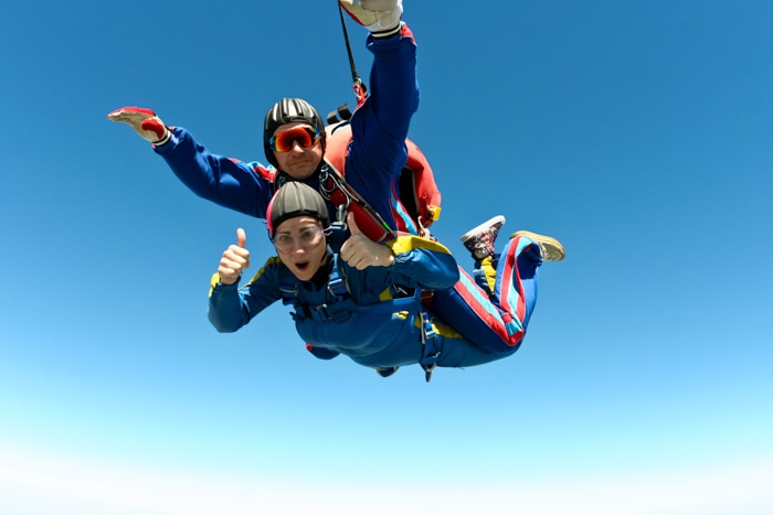 Couple sky diving together
